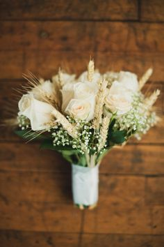 Bouquet with wheat; but with pink flowers