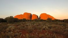 Uluru-Kata Tjuta is world-famous for its spectacular sunrises and sunsets. As the sunlight plays with the landscape, the rock formations change colour before your eyes. Visit Australia, The Rock, Monument Valley, Fun Facts, Sunrise, National Parks, Landscape, World, Amazing