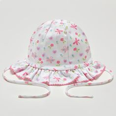 An adorable floppy hat for baby girls by Kissy Kissy. Made with 100% soft Peruvian pima cotton for softness and comfort. Cute colourful prints of butterflies, flowers and hearts. The hat secures with a tie under the chin. Perfect for protecting baby's delicate head on sunny days. Complete the look with matching items from Kissy …
