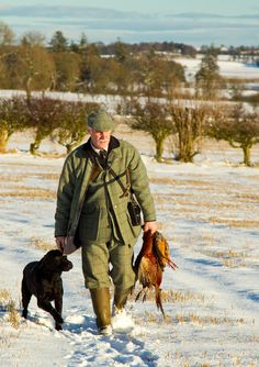 Lowland gamekeeper with dog at heel