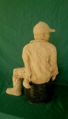 Patrick sitting clay sculpture