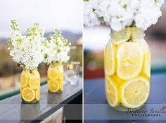 Lemons in blue mason jars or Lemons in clear mason jars with blue and grey ribbon for a boy baby shower.