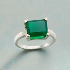 A bold, green, onyx gemstone draws the eye atop this beautiful, sterling silver ring.