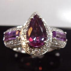Alexandrite set in platinum  with diamonds and amethyst