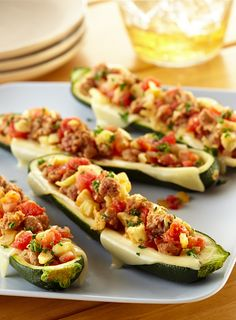 Spicy Italian Sausage Zucchini Boats — stuff zucchini with a mixture of spicy Italian sausage and cheese and grill for the perfect summer meal.