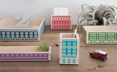 It's great when something gives you an excuse to have fun at your desk, and the Play-Deco Construction series from Twelvetone does just that. The collection of five different-sized wooden trays and containers are decorated to look like buildings — a post office, a school, a hotel, a station and, appropriately, an office block.