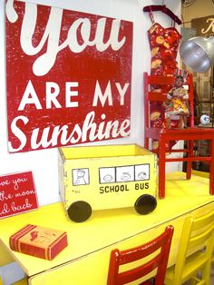 folk art school bus crate, awesome vintage yellow table and Sunshine sign!