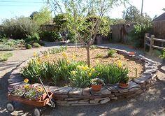 Old broken patio becomes a garden wall