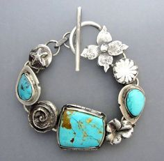 I love silver, flowers and turquoise, so this looks wonderful! Turquoise Flower Bracelet 2 by Temi on Etsy Luxury Jewelry, Boho Jewelry, Jewelry Art, Jewelry Bracelets, Silver Jewelry, Jewelry Accessories, Fashion Jewelry, Jewelry Design, Silver Ring