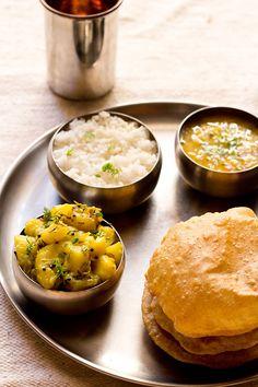 poori bhaji or batata bhaji recipe. step by step poori bhaji recipe. this poori bhaji recipe is the maharashtrian version of potato curry with pooris. this is a dry potato curry served with pooris.