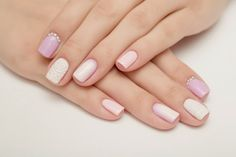 Gentle pink shades of feminine nails harmonises with white color. Each nail is decorated in its own way: volumetric decor ...