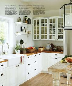 This kitchen is as perfect as you can get (minus the crazy expensive non modern looking custom fridge I would have in my kitchen if I were a billionaire.) I love the white cabinets with wood counters, floor, and island. I love the mix of open shelving and upper cabinets with glass doors. I love the sink (and every sink needs a window to look out.) Even the drawer pulls are my favorite kind.