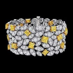 Graff Diamond Leaf Motif Bracelet Delicate pavé diamond leaves are interspersed 26 radiant cut yellow diamonds.