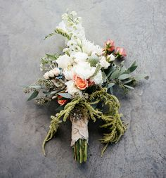 Textural, free-form bouquet ~ seeded eucalyptus, succulents, peach roses, pods, lisanthus, hanging amaranthus...
