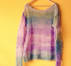 Hand knitted oversized blouse/ tunic in moss green aqua and lilac shades .Multicolor hand knit tunic is made loose fit with extra long sleeves.Mohair