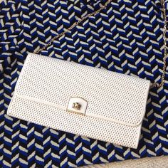 NWOT clutch White summer clutch is in mint condition because it was never worn. It has a long gold chain to carry it either cross body or hide the chain inside and carry it like a clutch. Either way you win with style ;)) Urban Expressions Bags