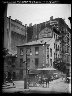MacDougal St. at the SW corner of 8th St., 1937. P.L. Sperr via NYPL.