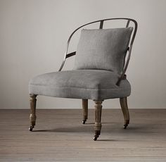 RH's Couturier's Chair:Our French couturier's chair recalls those used in the premier fashion houses of Paris when fitting well-heeled clients. Low to the ground, armless, exceedingly comfortable and petitely proportioned, it works perfectly in the bedroom, sitting area or foyer. Hand built, it has an exposed metal frame and curved oak legs fitted with antiqued casters.