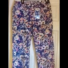 Kids Flower Super Skinny Ankle Jeans It is kids clothing. It is BRAND NEW. It has tags. They are super skinny ankle jeans and size youth 16 1/2. Justice Jeans Skinny