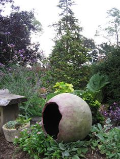 Homemade concrete sphere for the garden. I would like to make some of these as stray cat shelters - lots of cats in my backyard.