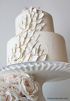 Sugar-paste leaves tipped with edible gold! Another beautiful intricate cake by The Pastry Studio.
