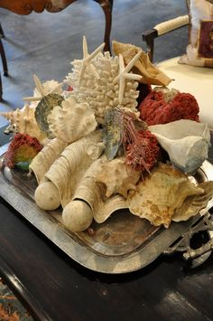 Display shells, coral and starfish on an old silver tray to add beach style to your space. After the season is over, just take the tray away or replace the shells and coral with a more appropriate seasonal display.