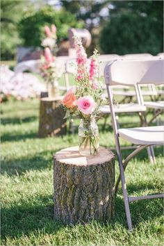 rustic stump and floral as wedding ceremony aisle decor / http://www.himisspuff.com/rustic-wedding-ideas-with-tree-stump/7/