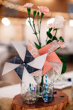 Pinwheel centerpieces | Pinwheel Filled Whimsical Red Barn Wedding With Vintage Touches | Photograph by Blest Photography  http://storyboardwedding.com/pinwheel-whimsical-red-barn-wedding-vintage/