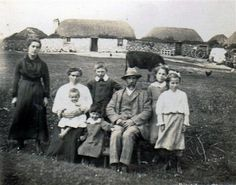 The McDonald croft, Kilmoluaig   (photo courtesy of Erica McKellar & James Galbraith McDonald)     Pictured c.1915 in front of their traditional Tiree croft home at Kilmoluaig. The croft buildings in the background are typical of those in Tiree in the 1800s, with the house, byre, sheds and stackyard built in a line.