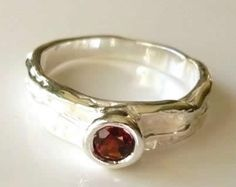 Available in sizes M, O and R, these are lovely silver garnet rings set with 5mm, round, faceted, wine red garnets. The silver shanks are satin finished but with the highlights polished to make them quite special. £35