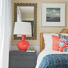 In the master suite of this Kiawah Island, South Carolina, cottage, a mirror with a scalloped frame reflects the light, which makes the tiny space look larger. | Coastalliving.com