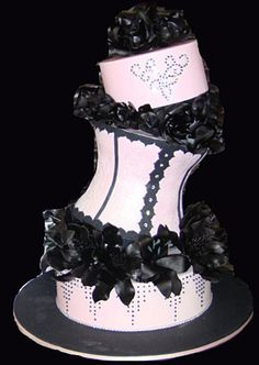 This is friggin awesome!!! Would make an amazing dirty thirty bday cake!! Black and white corset cake.