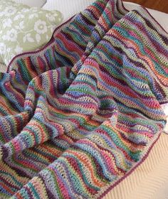 Scrumptious Scraps pattern, done in pretty colors.  Lots of different looks with this depending on color choices & order of stripes.  Size easy to adjust, good tips on Ravelry page.  #crochet #stripes #waves #afghan #throw #blanket