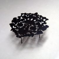 Inkblot table, 2007, on sale.    Laser cut steel, powder coat.    Inspired by Rorschach inkblot tests and from my interest in randomness creating form.   The tabletop form was chosen from many actual inkblots created by ink on folded paper