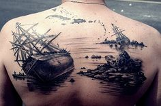 The wrecked ships back tattoo~ how cool is this? Though, it may be a bit overboard. *grin*