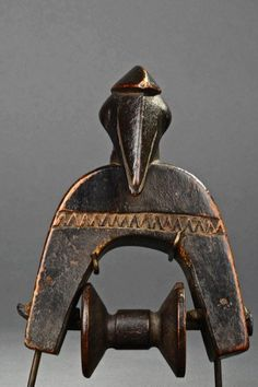 Africa | Heddle pulley from the Senufo people of Ivory Coast | Wood | Image ©Michel Renaudeau