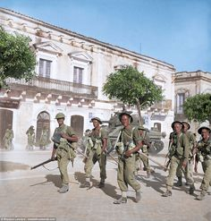 Husky' July 1943 Allied troops and a Sherman tank pass through the Piazza Vittorio Emanuele, Pachino in Sicily. (Photo source - IWM -Keating, Geoffrey (Major) No. 2 Army Film & Photographic Unit) (Colourised by Royston Leonard British Army Uniform, British Uniforms, Ww2 Uniforms, British Soldier, Italian Campaign, Military Drawings, British Armed Forces, Ww2 Pictures, North Africa