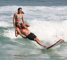 Talented Couple Makes Waves by Performing Impressive Tricks on a Single Surfboard - My Modern Met