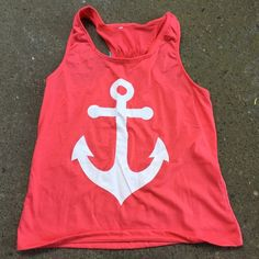 Pinkish coral tank top with bow Super cute tank top size is xxl but runs a little small. Tops Tank Tops