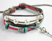 brown leather bracelet rivet red stone with wood beads and shell cross pendant z453. $9.50, via Etsy.