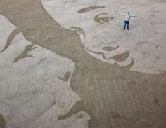 Immagine di http://static.qnm.it/www/fotogallery/979X0/65207/dipinti-nella-sabbia-esempi-spettacolari-3.jpg.