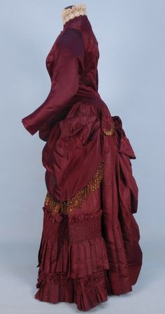 """historicaldress: """" SILK BUSTLE DRESS with BEADED TRIM, c. claret satin and taffeta having iridill fringe, buttons and crescent ornament, boned polonaise bodice ruched into back bow,. 1880s Fashion, Edwardian Fashion, Vintage Fashion, French Fashion, Vintage Dresses, Vintage Outfits, Victorian Dresses, Vintage Clothing, Women's Clothing"""