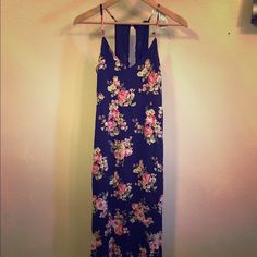 Long Floral Dress Long length dress: floral, black, red, and olive colors. 100% Rayon and lining: 100% polyester. Never been worn. Forever 21 Dresses