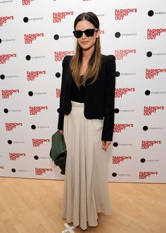 Rachel Bilson paired her dark shades with a matching blazer and a maxiskirt.