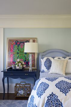 Talk about mixing it up .. We used this great @potterybarn bedding and area rug in this Guest Bedroom.. A Vintage Hermes scarf .. painted a vintage side table to use as a bedside table and gave this room a whole new look!  Mixing and Matching bed linens is one of my favorite ways to add color and pattern to a bedroom. #mypotterybarn   Interior design: Jennifer Mehditash  Photo: John Gruen Styling: Raina Kattelson MehditashDesign.com