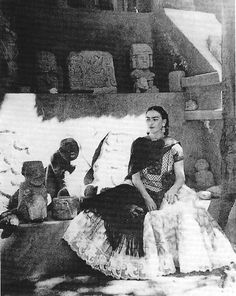 Frida Kahlo is sitting in the garden at Casa Azull~Photo taken by Antonio Kahlo (circa 1952/53)