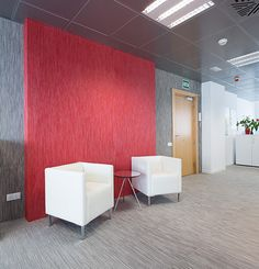 Chilewich floor and wall textiles in sleek gray and red at CSL Behring. A smart and beautiful interior design for the modern office.