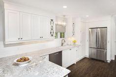 A crisp white kitchen with Cambria quartz Summerhill countertops, vinyl plank flooring and stainless appliances. (Designer: Cassandra Nordell/Copyright William Standen Co. 2015)