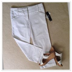 "NWT Chime white capris NWT Chime white capris. Two front slit pockets. Beautiful waistband just adds to these stunning capris. Materials consist of 76% rayon, 20% nylon, and 4% spandex. Very flattering. Perfect way to dress up without having to wear a dress when you don't want to. Approx measurements are 9"" rise and 22"" inseam. Chime Pants Capris"