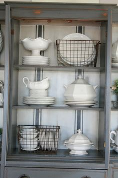 Grand Design: Grain sack stripe inspired hutch. the grey color looks beautiful and I love the grain sack copied in the back